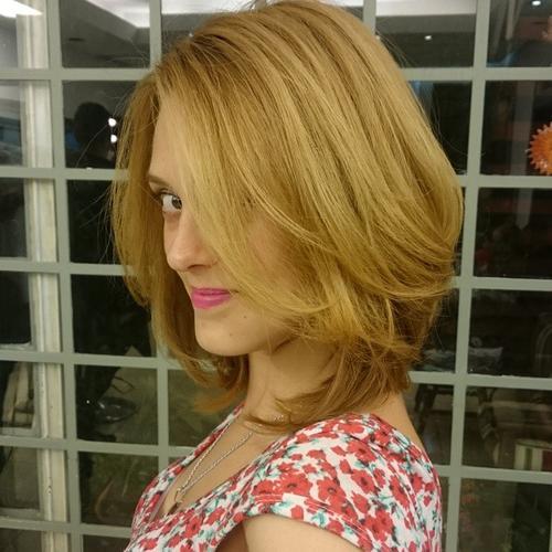 medium layered ginger blonde hairstyle