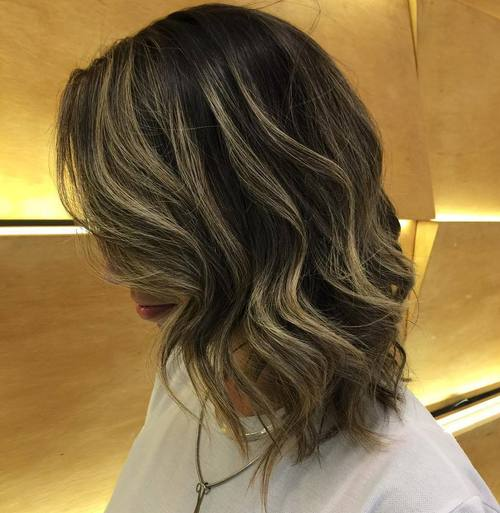 shoulder length wavy brown bob with highlights