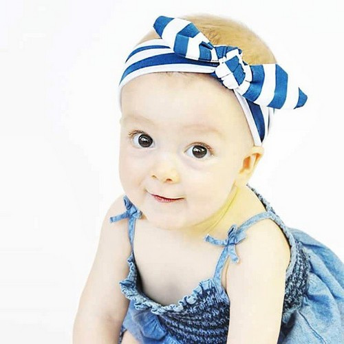 toddler with a headband hairstyle