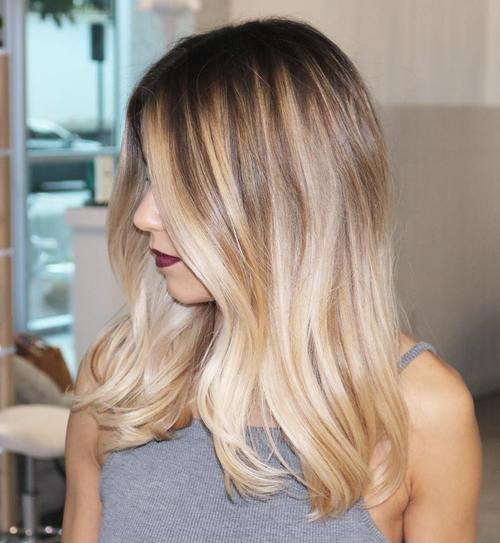 medium hair with balayage highlights and dark roots