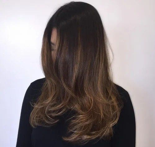 dark brown hair with subtle ombre highlights