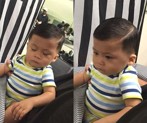 little boy's sleek side-parted hairstyle