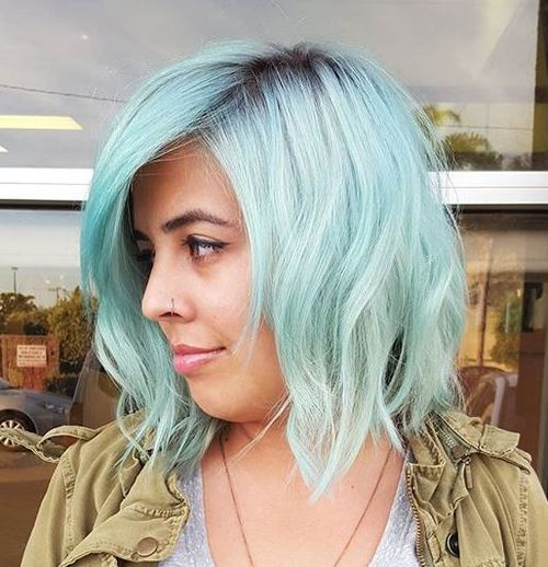 pastel blue hair with dark roots
