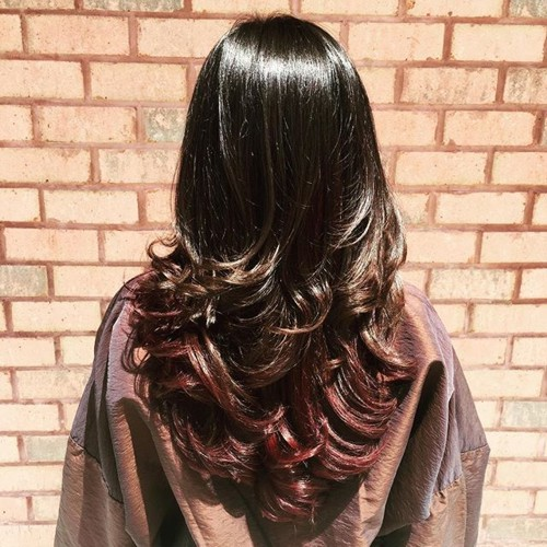 long brown V cut and curly hairstyle