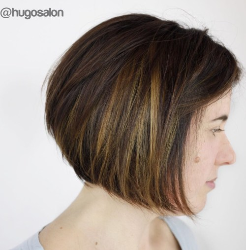 short dark brown hair with caramel highlights