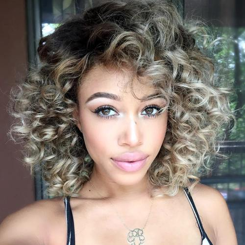 medium-length curly ash blonde hairstyle