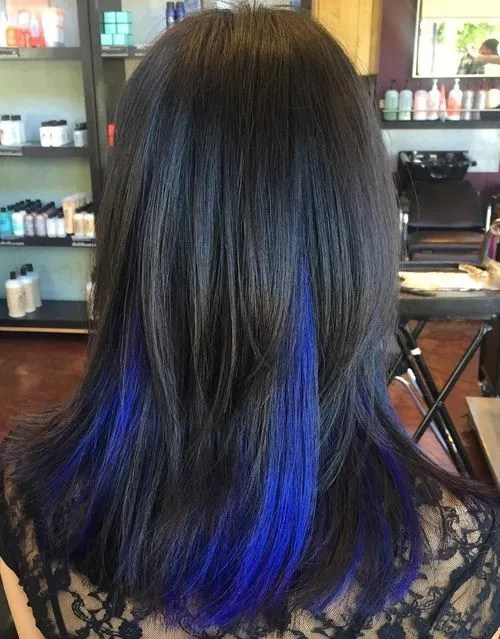 black hair with blue peek-a-boo highlights
