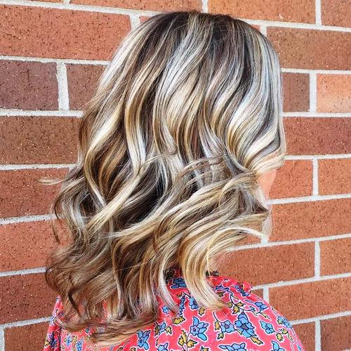 medium wavy brown blonde hairstyle