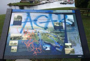 Walking tour plaque defaced, public input sought