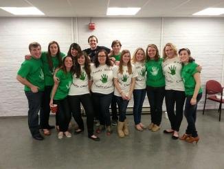 Seth Edward, Kaitlyn Weaver, Sarah Ward, Jenn Kelman, Christopher Cooper, Scarlett McMullan, Joey Bertoni, Amy Ward, Kelly Milligan, Christine Furey and Marisa Jay pose in their Sandy Hook Benefit Concert t-shirts.
