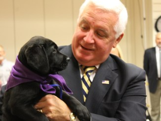 "Gov. Corbett expressing, ""puppy love."""