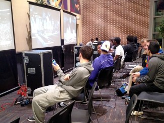 Students playing various video games on big screens. (Taylor Cole/Snapper)