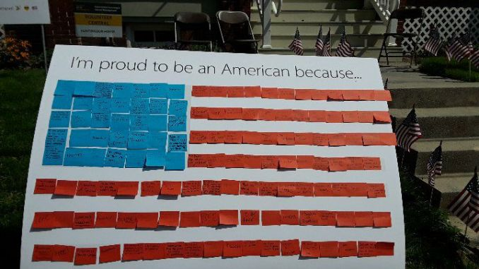 MU students wrote down why they were proud to be an American and placed their note on the post-it note flag (Photo courtesy of Maria Glotfelter).