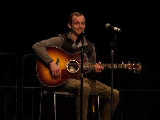 Aaron Wildonger played an original song during the talent show put on by the Student Athletic Advisory Committee. Photo by Brenden Curry.