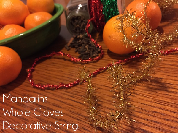 How to make beautiful and fragrant orange pomander ornaments. A craft easy enough for kids, but absolutely gorgeous on any tree!