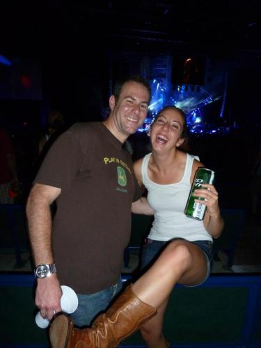 Showing off my boots at my last bday present: Luke Bryan and Jason Aldean concert!