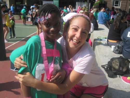 With my rock star runner. She ran the whole thing, even after falling!