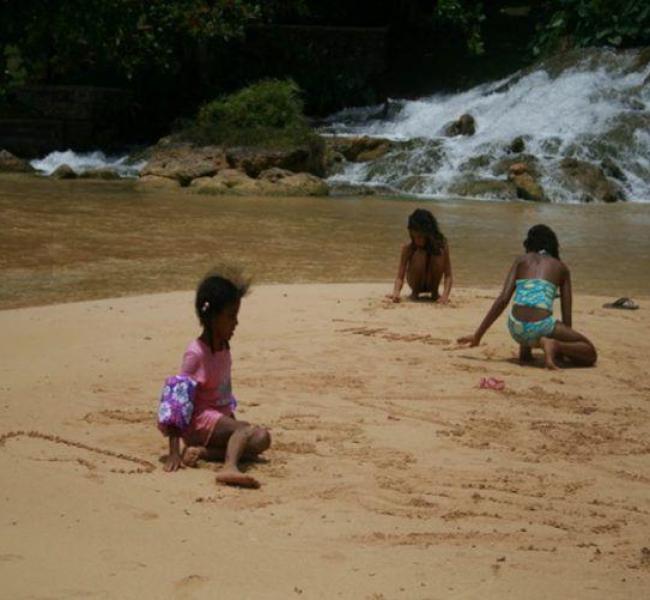 Visit Jamaica: Land I Love. Children frolicking on James Bond Beach.