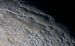 In this extended color image of Pluto taken by NASA's New Horizons spacecraft, rounded and bizarrely textured mountains, informally named the Tartarus Dorsa, rise up along Pluto's day-night terminator and show intricate but puzzling patterns of blue-gray ridges and reddish material in between. This view, roughly 330 miles (530 kilometers) across, combines blue, red and infrared images taken by the Ralph/Multispectral Visual Imaging Camera (MVIC) on July 14, 2015, and resolves details and colors on scales as small as 0.8 miles (1.3 kilometers). Credits: NASA/JHUAPL/SWRI