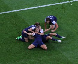 Carli Lloyd celebrates at the 2012 Summer Olympics after scoring a goal.  Photo By Christopher Johnson - Flickr: Women's soccer gains millions of new fans at London Olympics, CC BY-SA 2.0, https://commons.wikimedia.org/w/index.php?curid=20673939