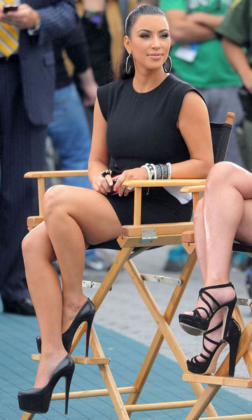 Kim Kardashian in her Louboutin Daffodiles during a Project Runway taping.