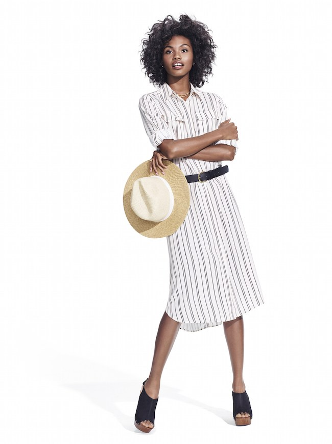 Studio-Model-wearing-black-and-white-pinstripe-shirt-dress-with-black-belt-straw-hat-and-black-wedge-slides