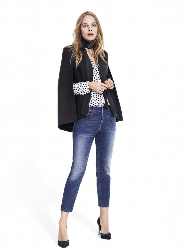 Studio-Model-wearing-black-cape-blazer-black-and-white-dot-blouse-distressed-ankle-jeans-and-black-pumps