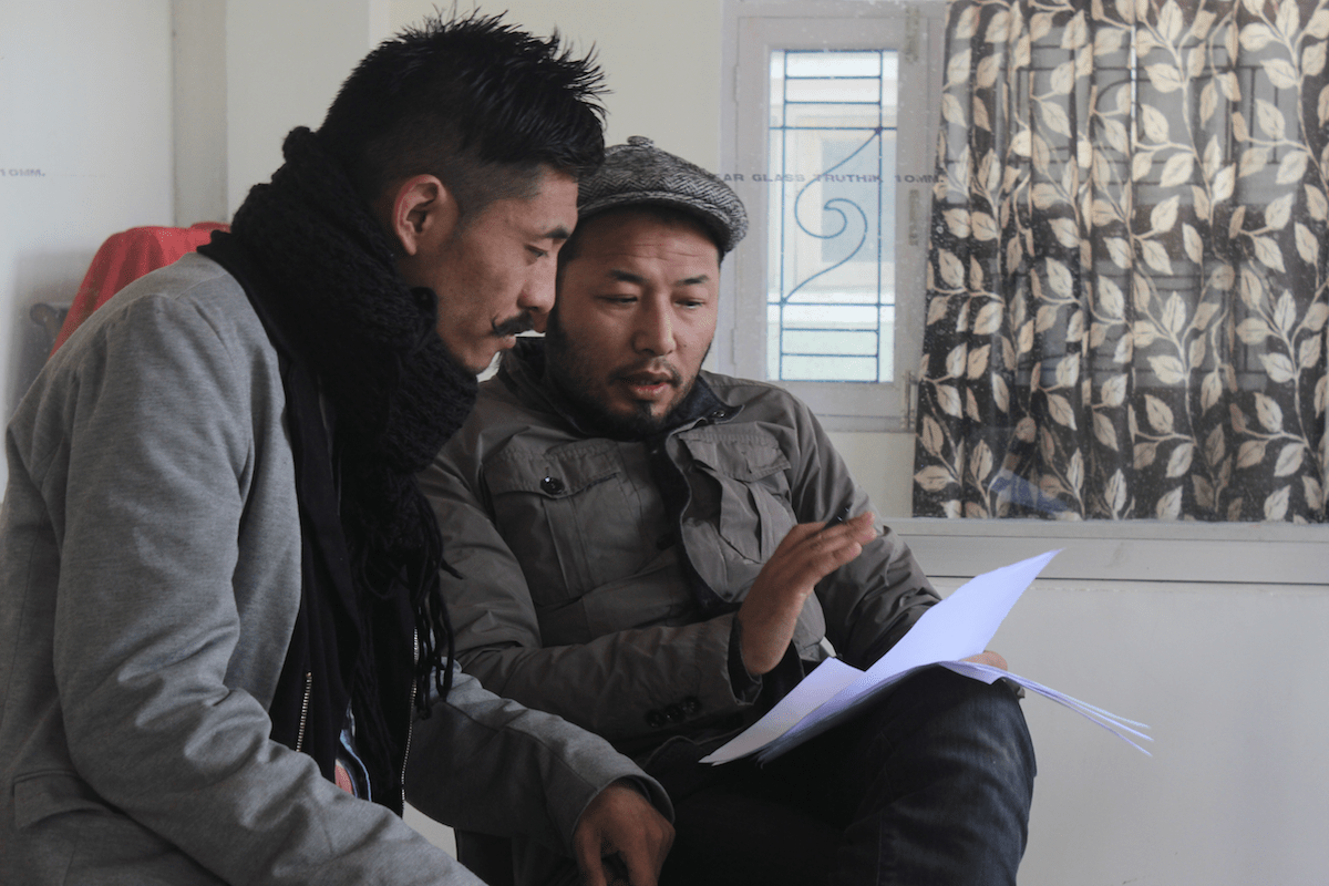 Assistant Director Sonam Tsetan playing a part during an applicant's audition