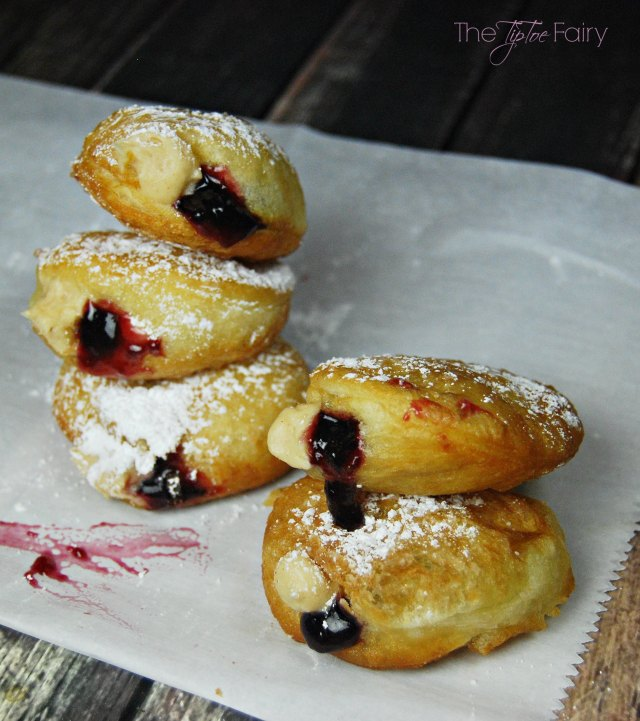 Peanut Butter and Jelly Donuts - made easily with crescent roll dough and filled with peanut butter mascarpone cream and jelly. Yum! | The TipToe Fairy