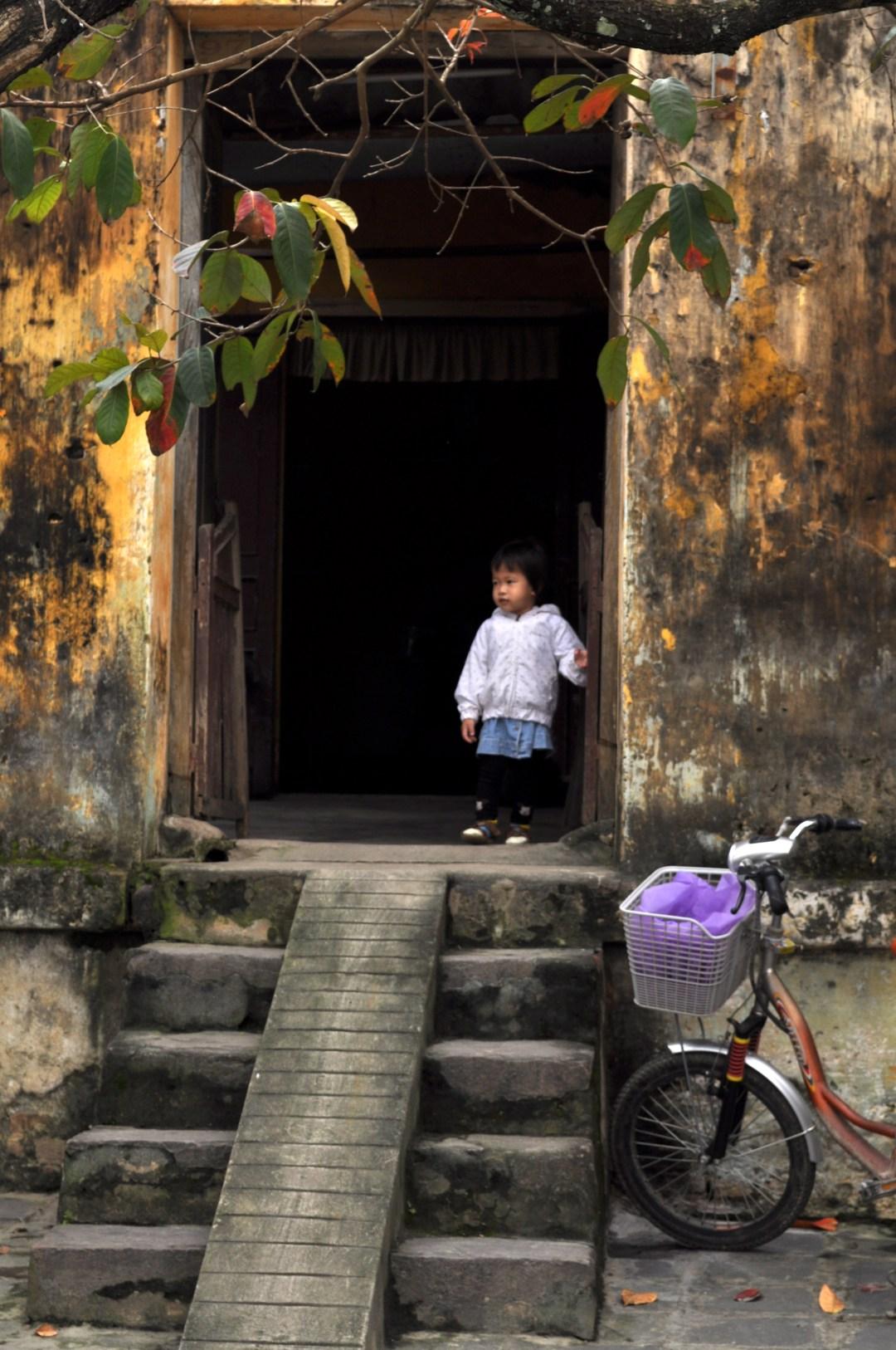 Small Child in Hoi An Doorway, Vietnam