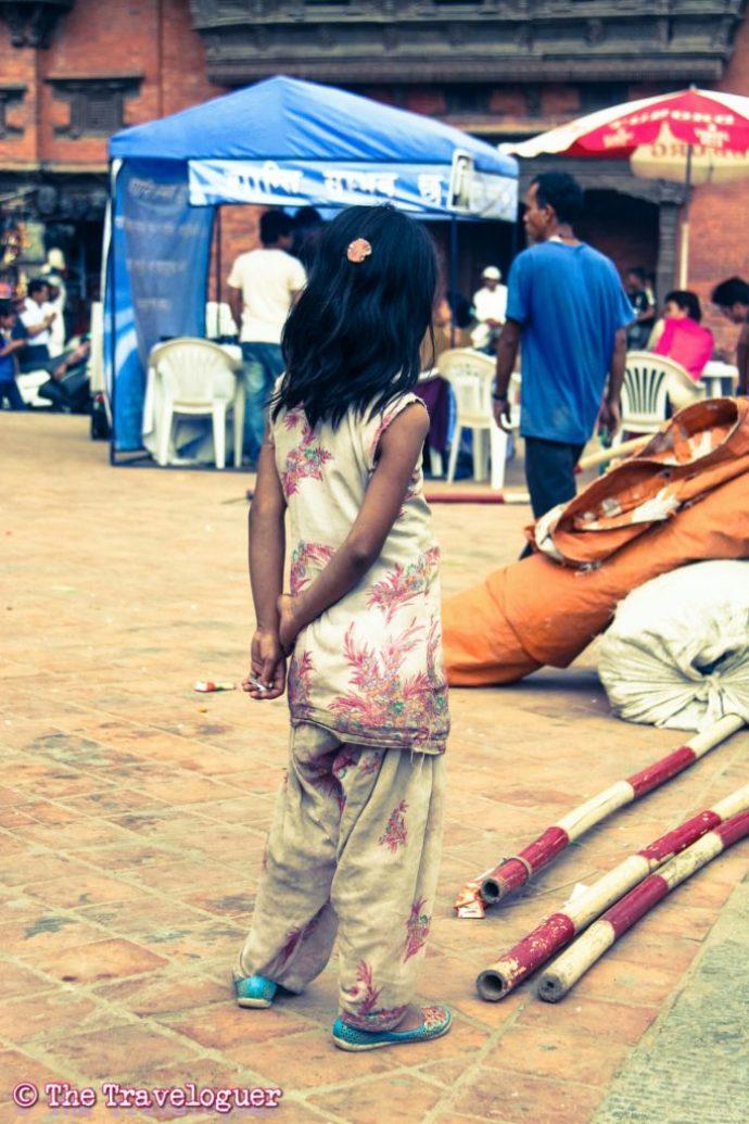 Kathmandu street photography - Thinking Girl, Durbar Square, Kathmandu, Nepal - Kathmandu Street Photography - thetraveloguer.com
