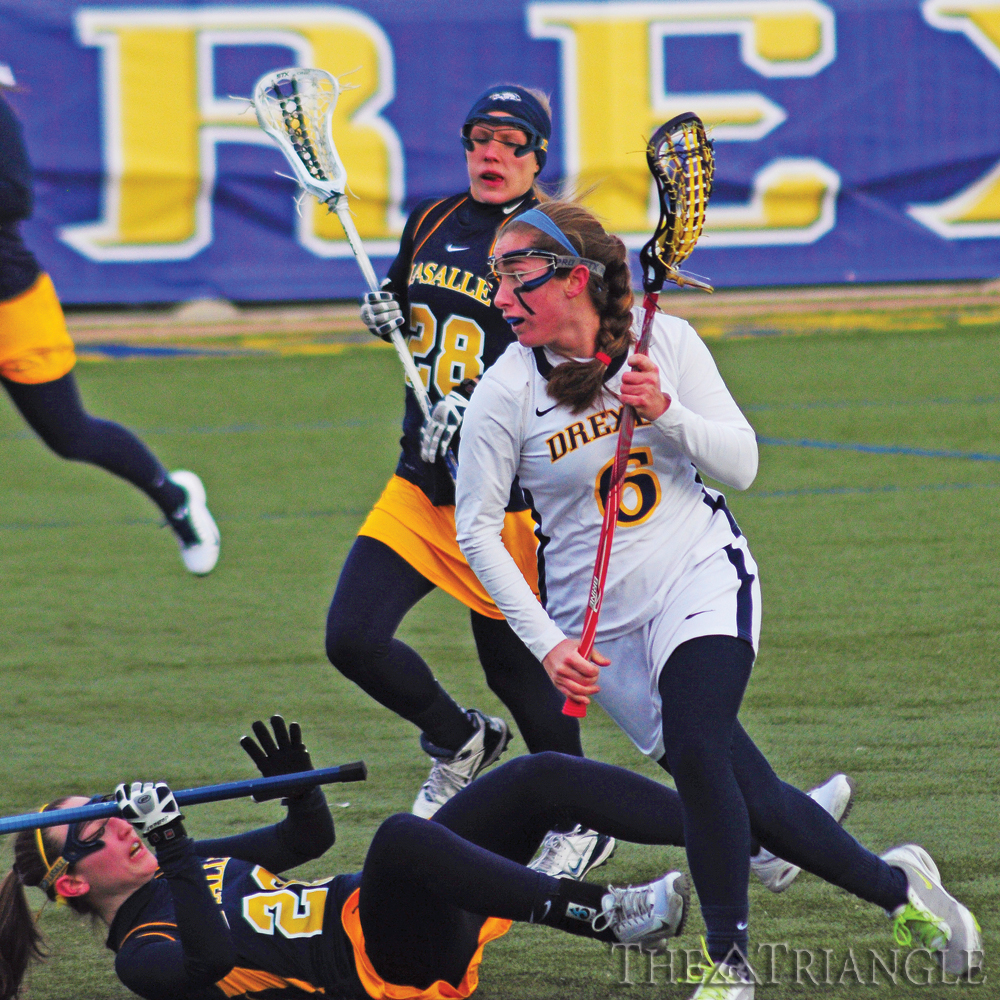 Junior midfielder Amanda Norcini runs past a La Salle University defender as she rushes up the field in the Dragons' 12-6 victory over the Explorers Feb. 20 at Vidas Field. Norcini contributed two goals on two shots and one ground ball.