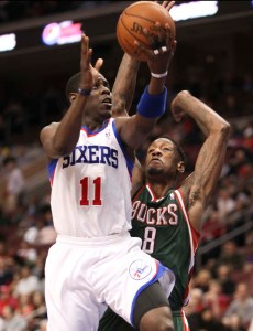 Philadelphia 76ers guard Jrue Holiday drives to the basket against Milwaukee Bucks center Larry Sanders at the Wells Fargo Center in Philadelphia March 27.