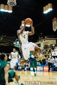 Senior point guard Frantz Massenat glides in for a layup during Drexel's 85-82 triple-overtime victory over Cleveland State University Dec. 4 at the DAC.