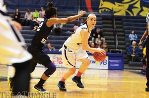 Sophomore guard Meghan Creighton looks for an open teammate during Drexel's 69-58 loss to James Madison University Feb. 16 at the DAC. The Dragons have dropped two straight games and their overall record now sits at 12-13 on the season.
