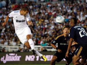 Karim Benzema attempts to head in a shot against the Los Angeles Galaxy. Benzema played a big role in Real Madrid's victory over Atletico Madrid.