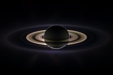 Saturn backlit by the sun.