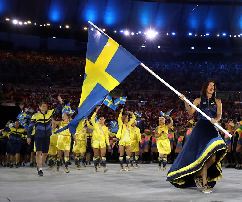 RIO DE JANEIRO, BRAZIL - AUGUST 05: Therese Alshammar of Sweden carries the flag during the Opening Ceremony of the Rio 2016 Olympic Games at Maracana Stadium on August 5, 2016 in Rio de Janeiro, Brazil. (Photo by Cameron Spencer/Getty Images)