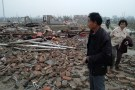 A man stands on debris of houses after a tornado hit Funing county, Yancheng, Jiangsu province, China June 23, 2016. China Daily/via REUTERS EDITORS - THIS PICTURE WAS PROVIDED BY A THIRD PARTY. EDITORIAL USE ONLY. CHINA OUT. NO COMMERCIAL OR EDITORIAL SALES IN CHINA.     TPX IMAGES OF THE DAY  - RTX2HSB4
