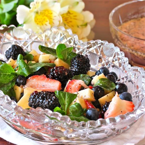 strawberries, blackberries, blueberries, pineapple, gorgonzola and ginger poppyseed dressing