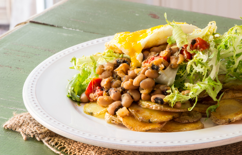 Black-eyed peas with frisée and a fried egg