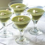 Watercress and buttermilk vichyssoise with a dollop of mascarpone, served as a starter in shooter glasses.