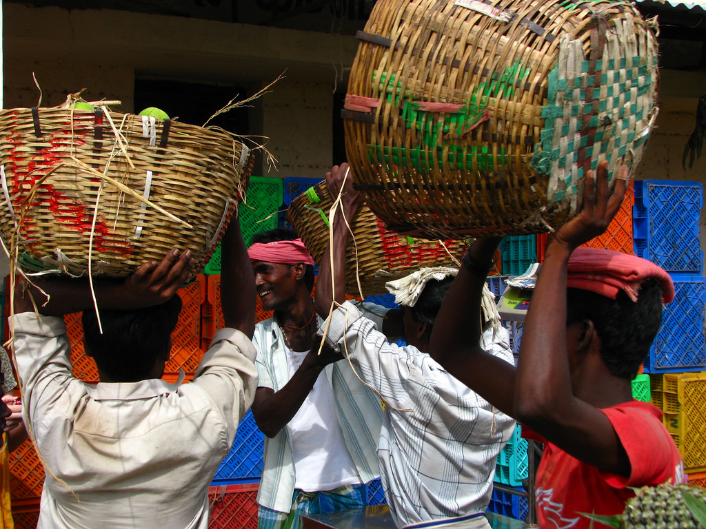 Labourers unload fresh fruits from a truck in Koyambedu Market, Chennai, 2009. Credit: mckaysavage/Flickr, CC BY 2.0