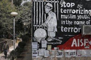 A man walks past graffiti inside the Jawaharlal Nehru University (JNU) campus in New Delhi. Credit: Anindito Mukherjee/Reuters