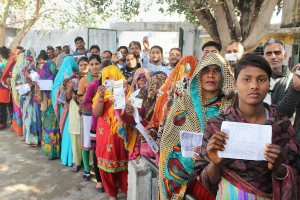 Meerut: Voters wait in queues to cast their votes during the first phase of UP Assembly polls in Meerut district on Saturday. PTI Photo     (PTI2_11_2017_000240B) *** Local Caption ***