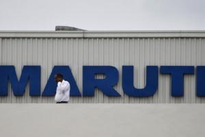 A man stands on the roof of Maruti Suzuki's plant at Manesar, in Haryana August 21, 2012.  REUTERS/Mansi Thapliyal/Files