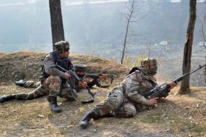 Uri:  Army personnel take position after the suicide attack by militants at Mohura Army camp, in Uri on Friday. PTI Photo (PTI12_5_2014_000023B)