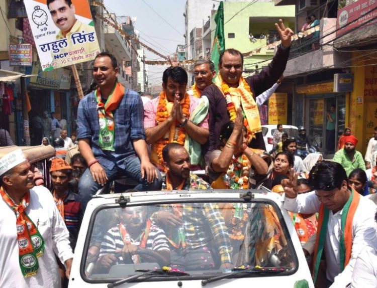 Delhi Bjp President Manoj Tiwari with MP Mahesh Giri along with BJP Candidate Vikas Yatra during the municipal election (MCD) campaign in East Delhi on Friday