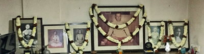 Garlands around the portraits of the lineage.