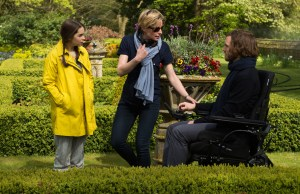 """(L-r) EMILIA CLARKE, director THEA SHARROCK and SAM CLAFLIN on the set of New Line Cinema's and Metro-Goldwyn- Mayer Pictures' romantic drama """"ME BEFORE YOU,"""" a Warner Bros. Pictures and Metro-Goldwyn- Mayer Pictures release. Photo by Alex Bailey"""